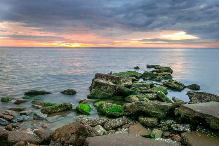 Beautiful Sunrise and Seascape. Grand View Island, Fox Hill, Hampton, Virginia Cloudy Reflection Beauty In Nature Clouds And Sky Horizon Over Water Nature No People Outdoors Refection Rock - Object Scenics Sea Sky Sunrise Tranquil Scene Tranquility Water