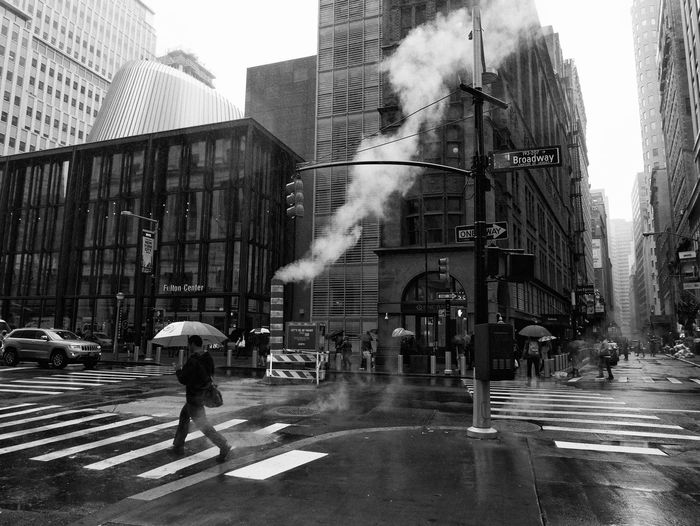Architecture Blurred Motion Building Exterior Built Structure City Day One Person Outdoors Real People Smoke - Physical Structure Street