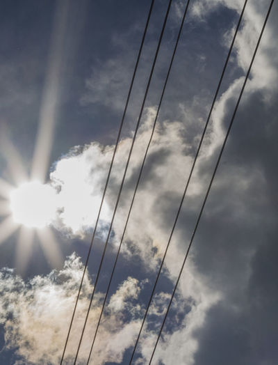 Stromleitung Beauty In Nature Cable Cloud - Sky Day Electricity  Low Angle View Nature No People Outdoors Power Supply Sky Sun