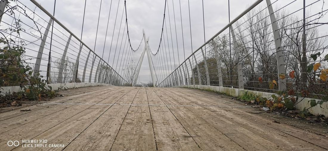 View of suspension bridge against sky
