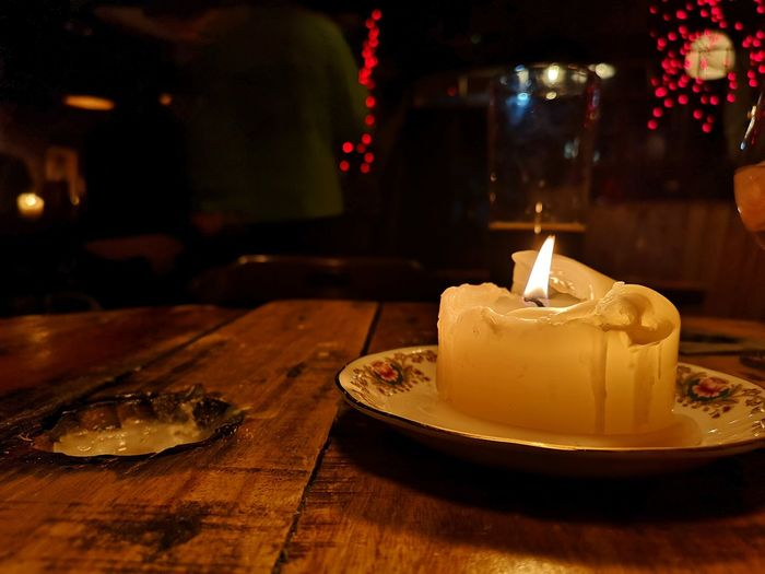 Fairy Lights Glow Wood - Material Tabletop Bar Yorkshire Dark darkness and light Dessert Table Celebration Cake Candle Flame Close-up Sweet Food Food And Drink Candlelight Burning Fire Wax Lit Fire - Natural Phenomenon Heat Darkroom Tea Light
