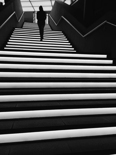 Staircase Steps And Staircases Architecture One Person Real People Pattern Railing The Way Forward Direction Indoors  Walking Lifestyles Day Rear View High Angle View Built Structure Moving Up Full Length Women The Street Photographer - 2018 EyeEm Awards EyeEmNewHere