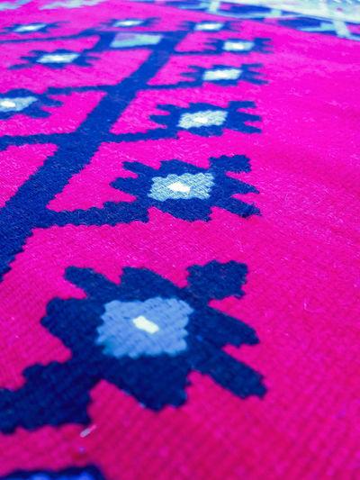 High angle view of text on rug