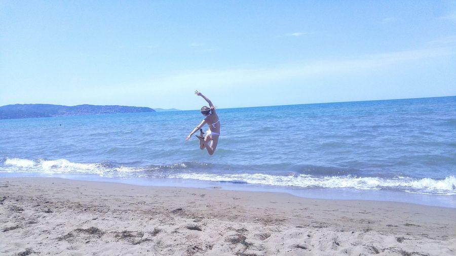 Sea And Sky Horizon Over Water Sand Blue Vacations Wave Summer Beach Fun Sun Jumping Jump Shot