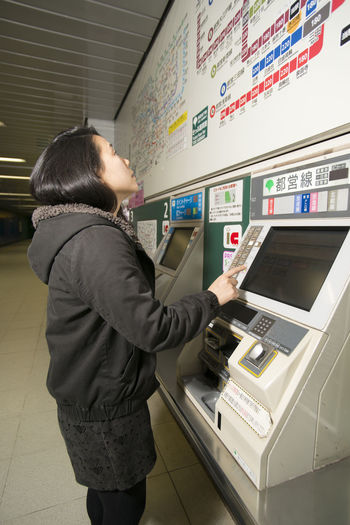 A young Japanese lady in the Tokyo subway. Commuter Japan Japanese  One Person Subway Subway Station Ticket Machines Tokyo Woman