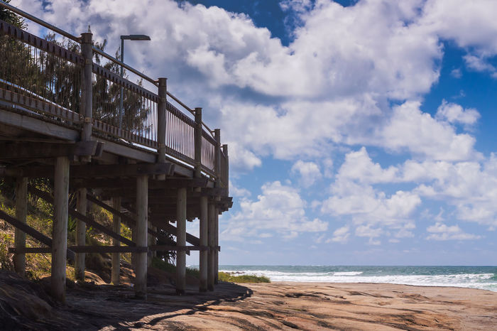 Boardwalk by the beach Australia Caloundra Cloud Composition Connection Ocean Outdoors Perspective Queensland Railing Sea Sky Structure Summer Tropical Climate Vacations Water