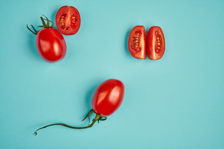 High angle view of tomatoes against blue background