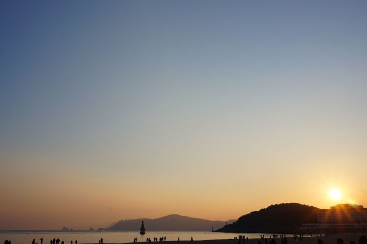 Sunshine Sunlight Hill Island Sunset Nature Scenics Beauty In Nature Water Tranquil Scene Tranquility Outdoors Sea Clear Sky Sky