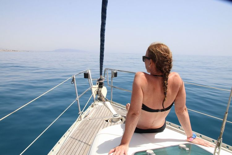 Beautiful Woman Beauty In Nature Bikini Boat Boat Deck Day Horizon Over Water Leisure Activity Mode Of Transport Nature Nautical Vessel One Person Outdoors Real People Sailboat Sailing Sea Shirtless Summer Sunlight Transportation Travel Vacations Water Yacht