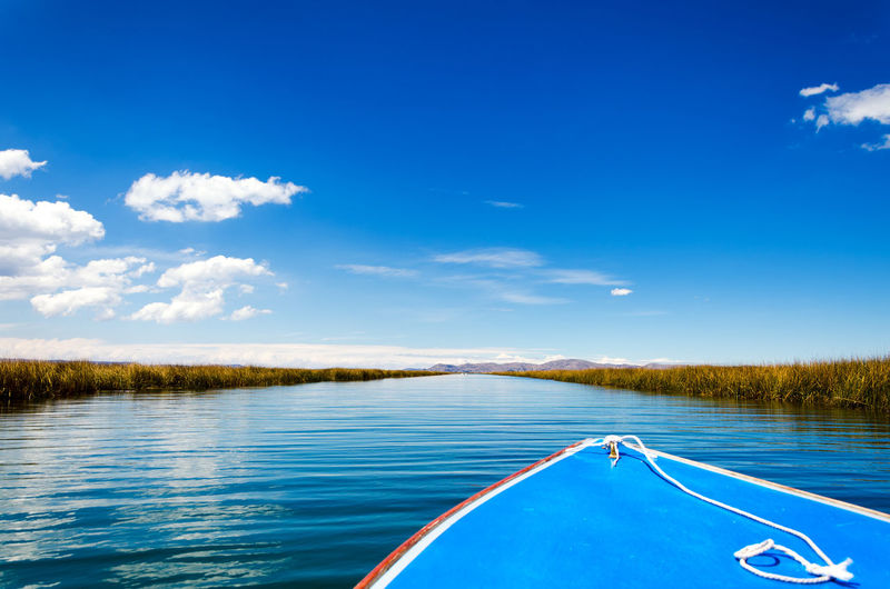 Front of a boat passing through a canal on Lake Titicaca in Peru Architecture Beach Boat Colorful Ethnic Floating Houses Inca Isla Island Islands Lake Landscape Manmade Peru Puno Puno, Perú Scene Titicaca Titicaca Lake Totora Tourism Uros Uros Island Water