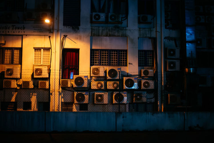 street air compressor Nightphotography Air Compressor Architecture Blue Building Building Exterior Built Structure City Dusk Food And Drink Illuminated In A Row Lighting Equipment Malaysia Neon Night No People Outdoors Residential District Side By Side Street Street Light Technology Window Yellow
