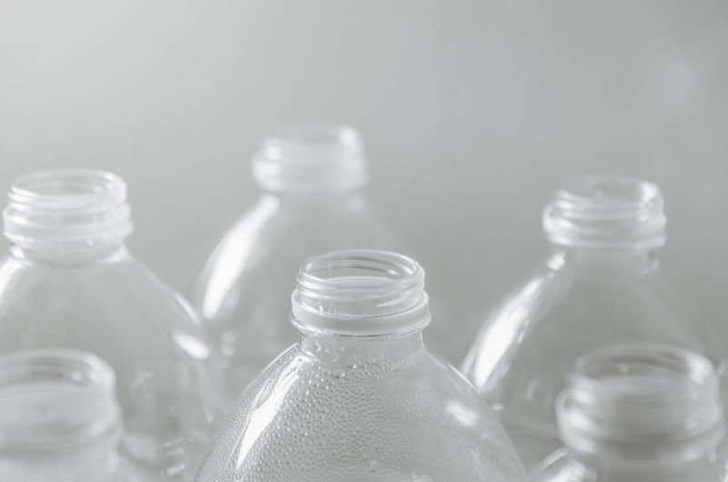 Close-up of drinking glasses on glass