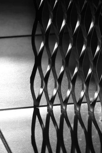 Alloy Backgrounds Close-up Day Design Flooring Geometric Shape Grate Grid Indoors  Metal Metal Grate No People Pattern Selective Focus Shadow Shape Silver Colored Single Object Steel Still Life Sunlight