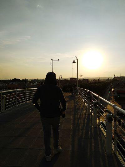 Pasaje por el atardecer Bridge Bridge - Man Made Structure Water Sunset Full Length City Silhouette Rear View Sky Rainy Season Road Marking Moving Dividing Line Yellow Line