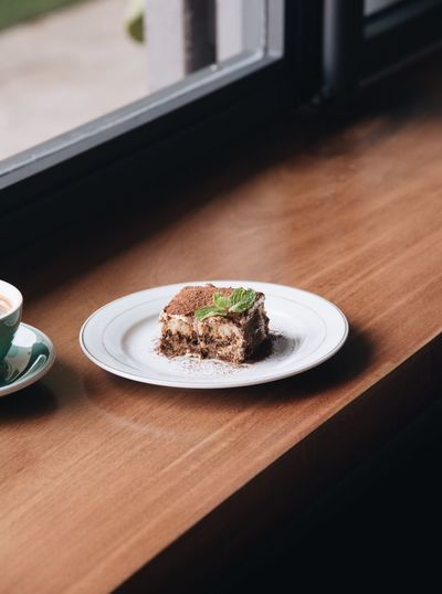 Tiramisu Plate Table Indoors  Food Food And Drink Still Life Dessert Sweet Sweet Food Indulgence Window Ready-to-eat Baked Unhealthy Eating Cake Freshness High Angle View No People Serving Size Temptation