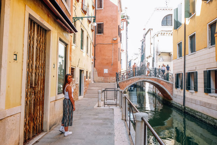 girl walking the streets of venice Italy Venice Venice, Italy Italy Travel Travel Destinations Summer City Architecture Built Structure Building Real People One Person Full Length Women Day Adult Walking Residential District Lifestyles Connection Outdoors Canal Alley Young Woman Tourist