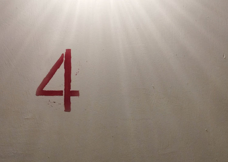 Red number four on the wall
