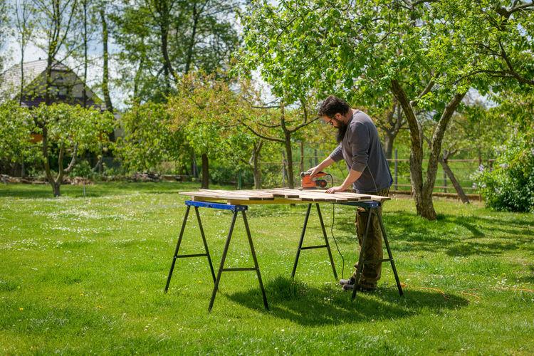 Full length of carpenter working outdoors