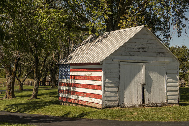American flag on hut in park