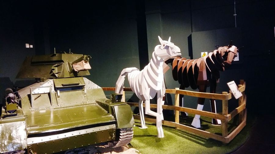 Two Wooden Horses Stood by a Tank at The Tank Museum in the Uk . Featuring No People Animal Themes Indoors  Texture Mode Of Transport World War 1 History Coming To Life Tank Museum Weapon Military Horse Museum History World War Transportation Technology Tanks