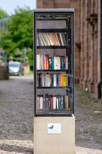 Close-up of open book on road