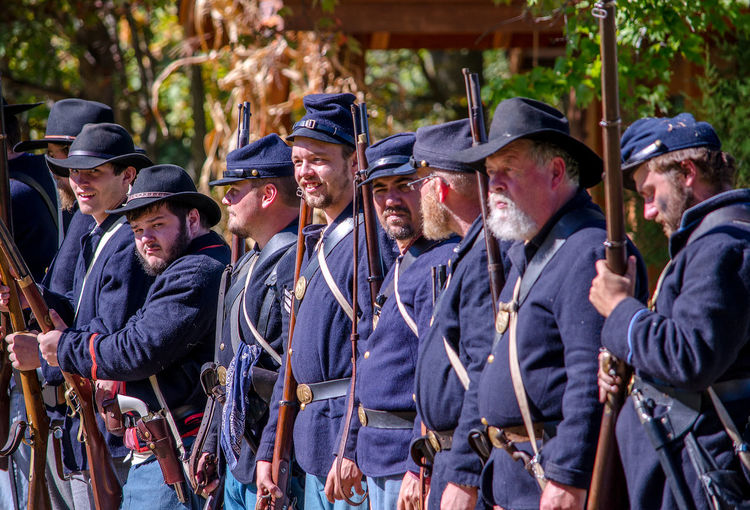 oct 8, 4th Annual Mooresville Civil War Days , South Haven, Michigan; union soldiers stand in a line as they prepare for battle during a civil war reenactment Acting Actors Camping Civil War Event Fight Michigan, USA Nature Soldiers USA Uniforms Union Armed Forces Clothing Editorial  Guns Men North Vs South Outdoors People Reenactment Uniform Weopons Young Adult Young Men