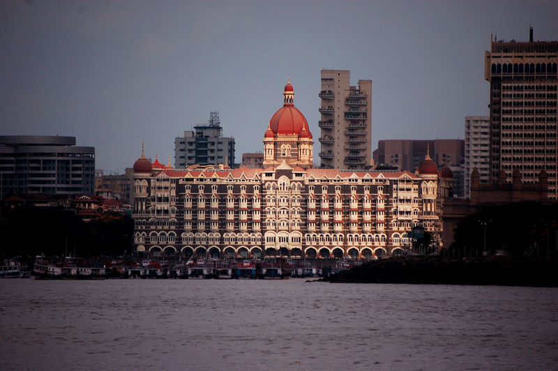 Historic the taj mahal palace in city against sky