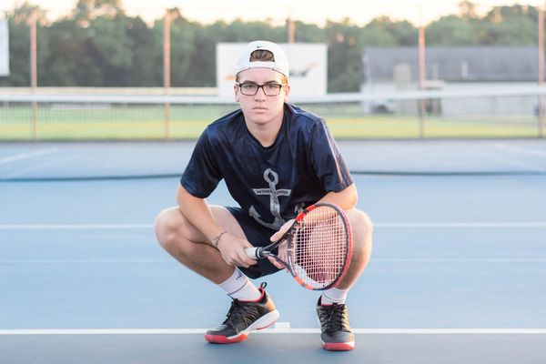 Stance. EyeEm Selects Sport Athlete Court Activity Lifestyles Teenager Exercising Ball Net - Sports Equipment Playing Tennis People Adult Healthy Lifestyle Portrait Young Adult Tennis Racket Competitive Sport Sports Venue Photographer Senior Pictures  Pennsylvania Conrad Weiser Senior Portrait