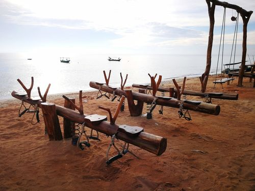 Wooden seesaw by the beach Sea Beach Sand Horizon Over Water No People Tranquility Nature Day Outdoors Water Sky Seesaw Made Of Wood Kuala Terengganu Malaysia