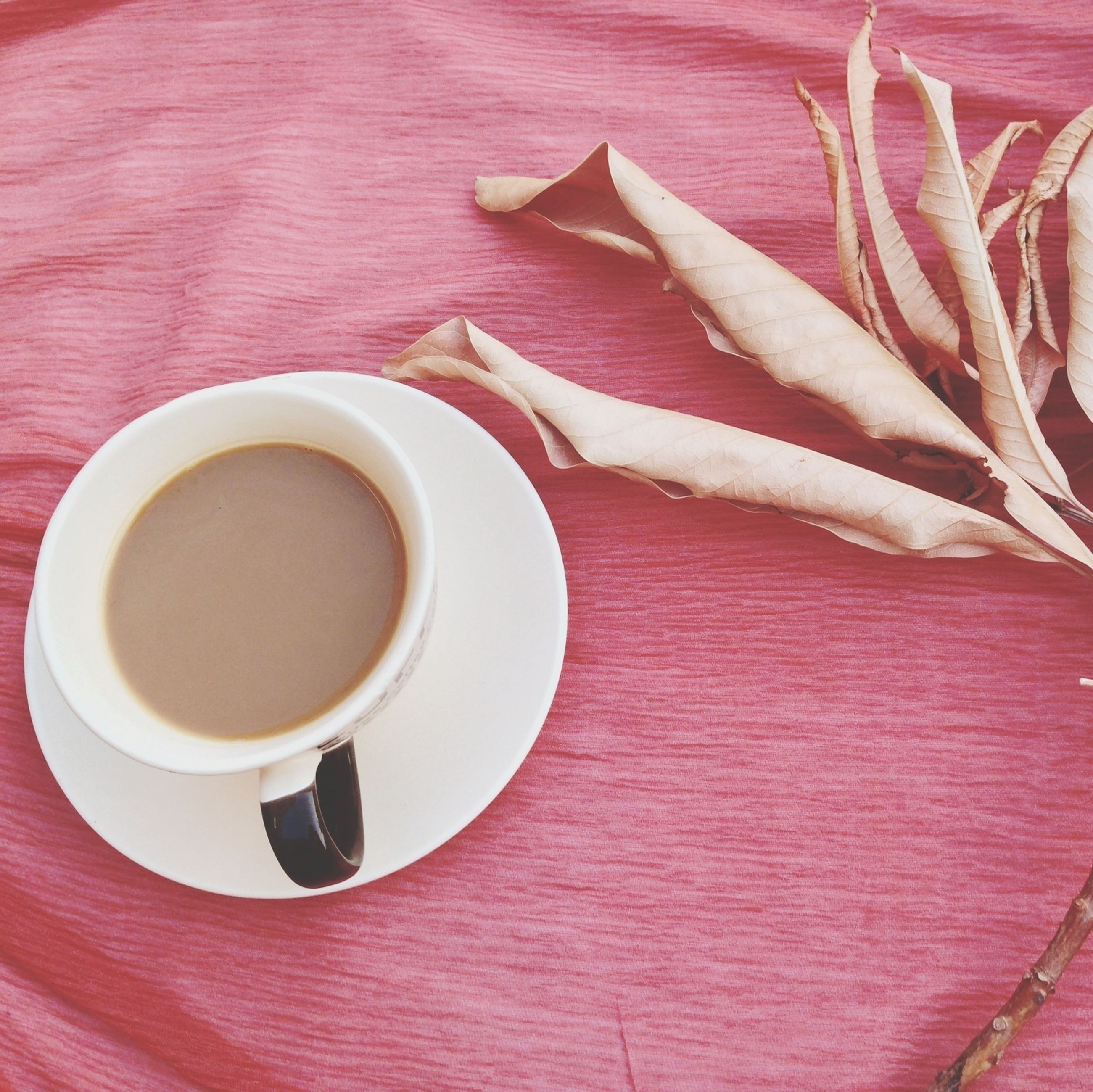indoors, food and drink, table, freshness, coffee cup, red, still life, drink, refreshment, high angle view, coffee - drink, directly above, saucer, close-up, cup, no people, white color, spoon, plate, wood - material