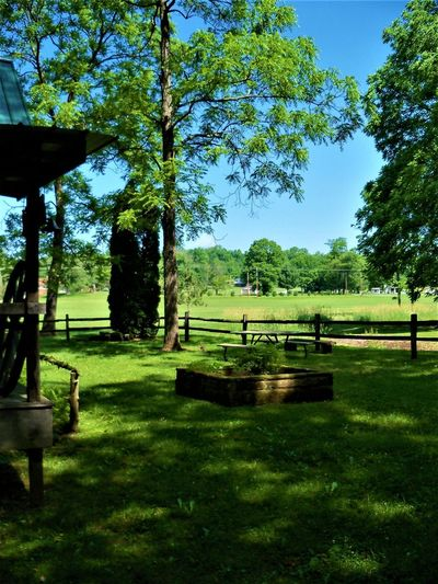 Country Life Indiana Porch Architecture Beauty In Nature Country Life Countryside Day Fence Field Grass Green Color Growth Land Landscape Nature No People Outdoors Park Plant Sky Split Rail Fence Sunlight Tranquil Scene Tranquility Tree