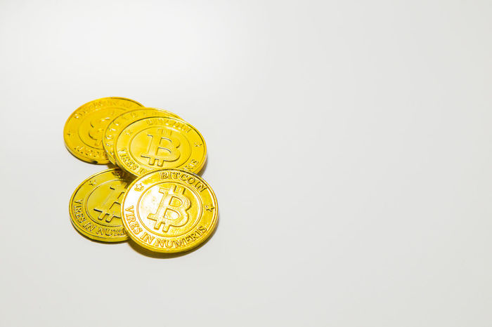 The Gold Bitcoinor BTC image Macro shots crypto currency Bitcoin coins electronic money. Bitcoin Bitcoin Cash Bitcoin Coin Bitcoin Miner Bitcoin Mining Bitcoin Stock Bitcoin Symbol Bitcoin Wallet Bitcoin Wallet App Bitcoins Close-up Coin Day Gold Gold Colored Golden Color Indoors  No People Studio Shot White Background Yellow