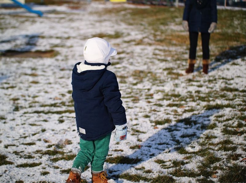 Decisions... Rear View Winter Warm Clothing Childhood Snow Cap Standing Real People Cold Temperature Nature City Life Winter Coat Winter In The City Leisure Activity Fresh On Eyeem  Made In Romania My Favorite Photo Found On The Roll Details Of My Life Fun Mother And Son Vscocam Playground Child Snow Covered The Street Photographer - 2017 EyeEm Awards