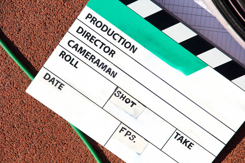 behind the scene, close up of Film Slate on set Film Equipment Filming Behindthescenes Clapper Board Clapperboard Close-up Communication Day Film Industry Film Slate Filming Location High Angle View Movie Clapper Board No People Number Text Tool