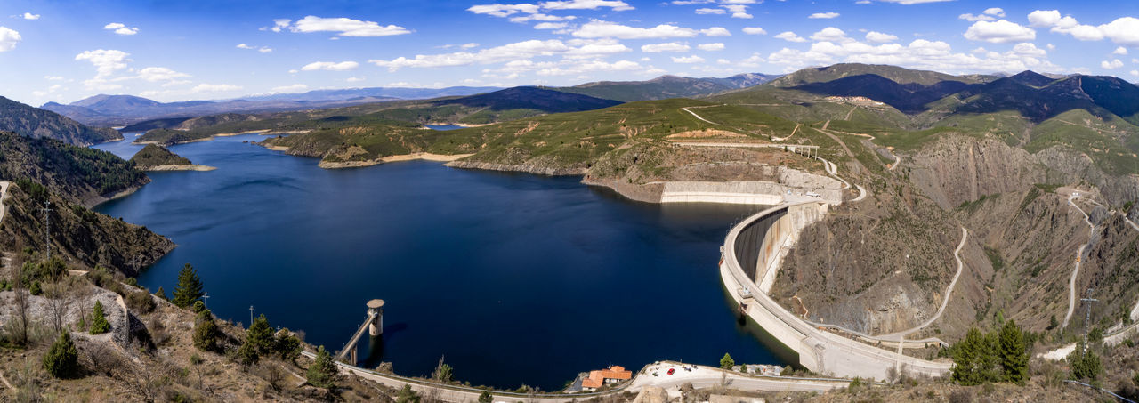 High angle view of dam on mountain against sky