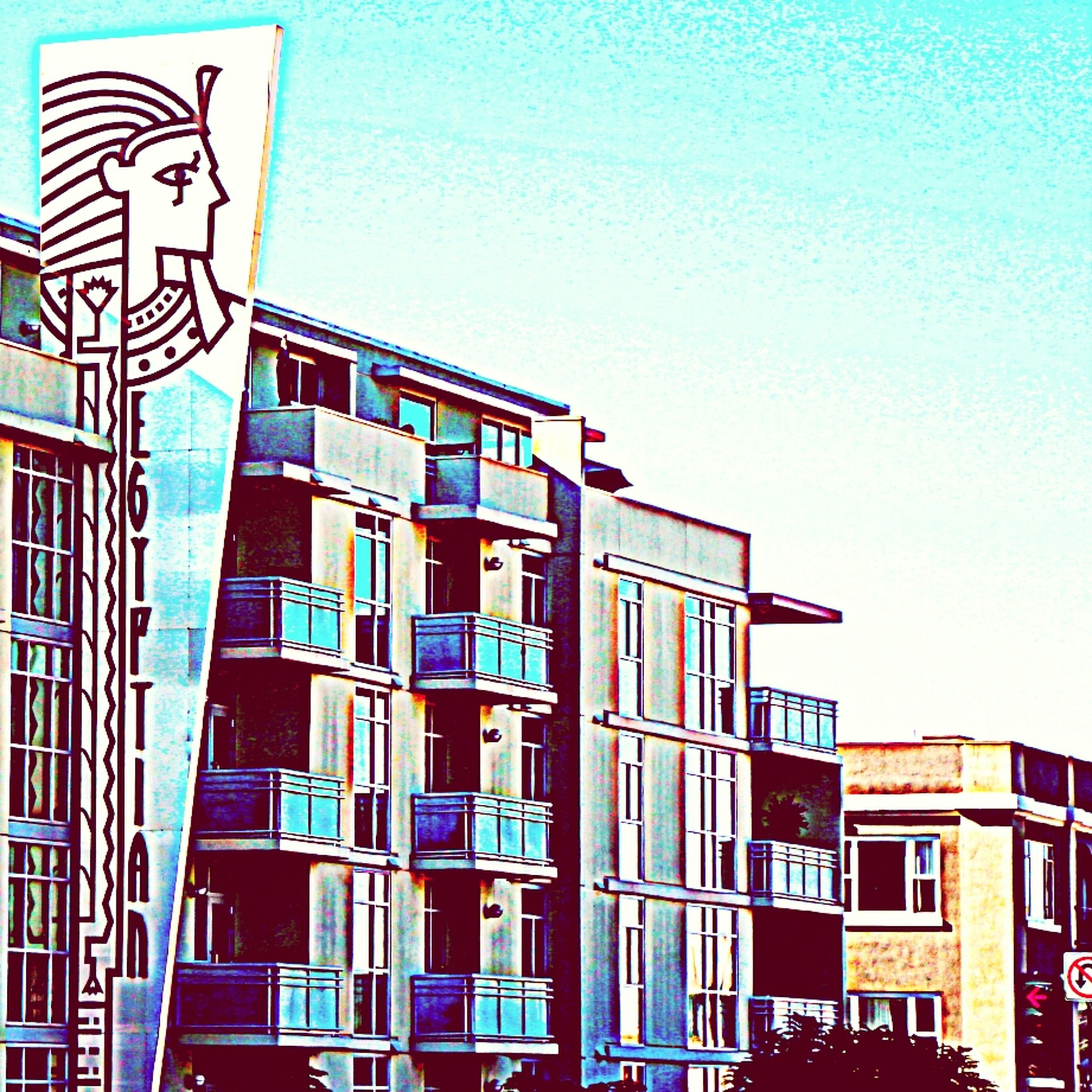 architecture, building exterior, built structure, low angle view, clear sky, window, building, blue, city, residential structure, residential building, copy space, day, no people, outdoors, in a row, modern, high section, multi colored, pattern