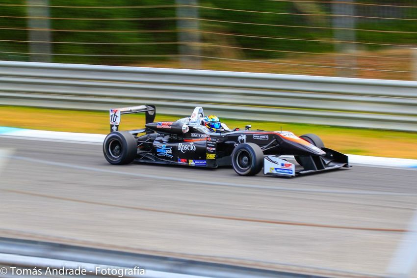 Sports Race Motorsport Speed Racecar Sport Auto Racing Competition Competitive Sport Sports Track Driving Formula One Racing Professional Sport Motion Car Blurred Motion Crash Helmet Day Outdoors Finish Line  No People