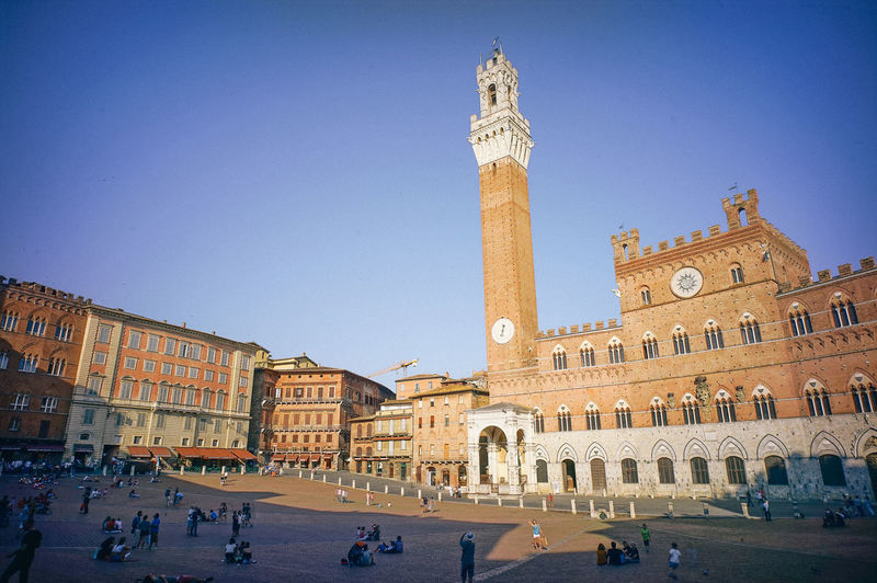 Old town on the mountain in Tuscany, Italy Architecture Built Structure Building Exterior Sky Group Of People Building Crowd City Clear Sky Real People Large Group Of People Travel Destinations Travel Nature History The Past Tower Tourism Town Square Men Outdoors Architectural Column Clock Tuscany Italy Old Town Square Old Town Europe Trip Summer Vacations Tuscan ,