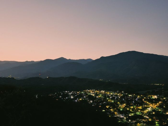 Beauty In Nature Building Exterior Clear Sky Day High Angle View Landscape Long Exposure Mountain Mountain Range Nature No People Outdoors Scenics Silhouette Sky Sunset Tranquil Scene Tranquility Tree