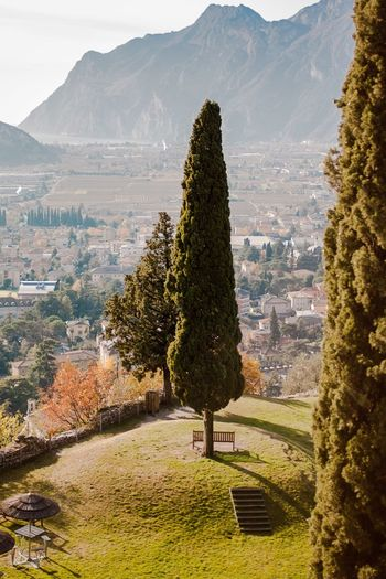 Mountain Travel Mountain Range Landscape Tree Travel Destinations Architecture Nature Scenics Outdoors No People Mountain Peak Day Sky Tree Town City Houses Nature Beauty In Nature Sunlight Tranquility Italianstyle Garda Tranquil Scene