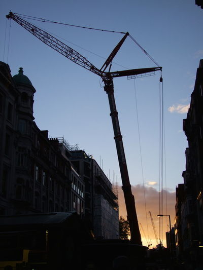 Crane Outline at Sunset Blue Sky Building Outline Buildings Capital City City Citylife Composition Crane Dusk Full Frame GB London No People Outdoor Photography Sunset Tourist Attraction  Tourist Destination Uk Unusual Yellow Clouds