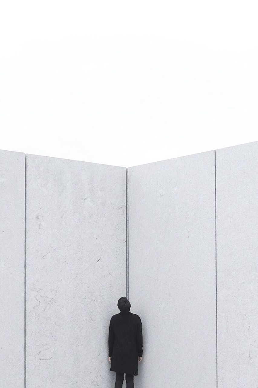 PEOPLE IN FRONT OF WALL IN OFFICE