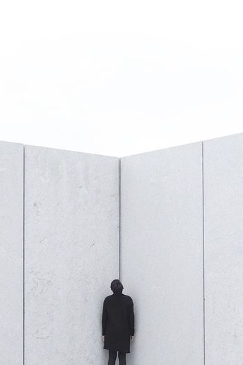 People in front of wall