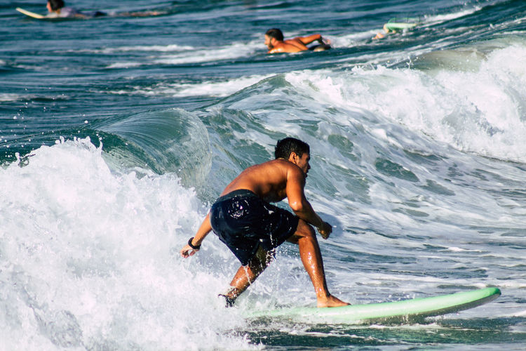 Rear view of shirtless man in sea