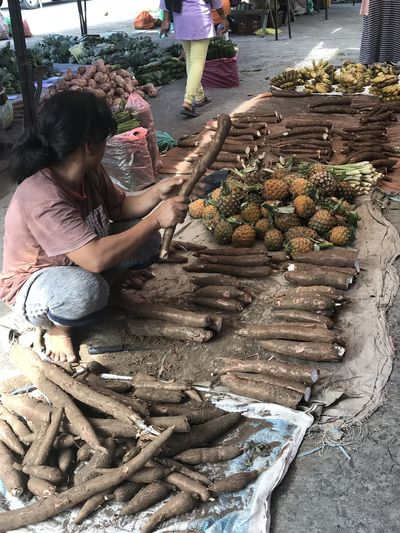 A woman from the rural area seated at the market Food Food And Drink Freshness Healthy Eating Market Real People Retail  Tapioca Women