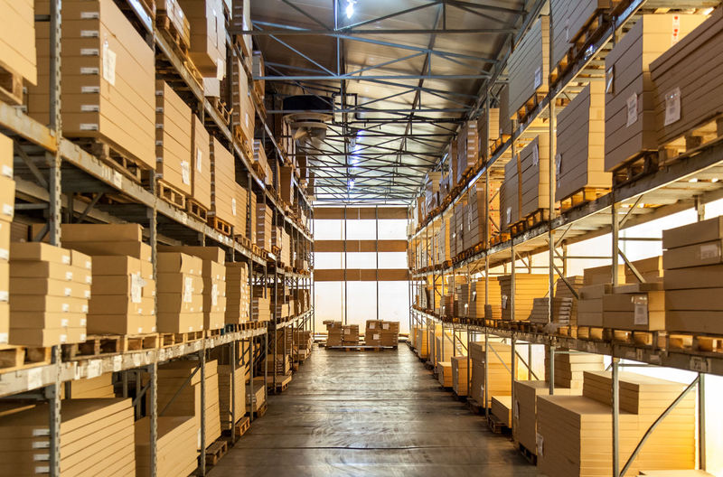 Box - Container Business Cardboard Box Cargo Container Checklist Crate Day Distribution Warehouse Factory Freight Transportation Indoors  Industrial Equipment Industry Large Group Of Objects No People Shelf Shipping  Stack Storage Compartment Storage Room Warehouse