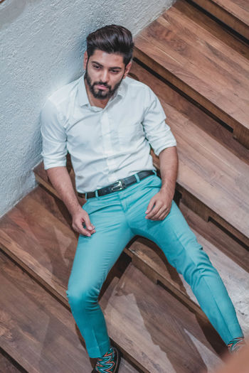 One Person Front View Young Adult Indoors  Casual Clothing Real People Young Men Standing Wood - Material Flooring High Angle View Full Length Wood Hardwood Floor Home Interior Looking At Camera Adult Sitting Jeans Exploring Fun Springtime Decadence The Portraitist - 2019 EyeEm Awards The Architect - 2019 EyeEm Awards The Traveler - 2019 EyeEm Awards