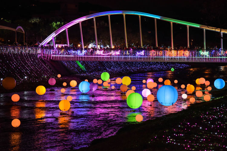 I feel really beautiful. Taiwan - February 17 2019: Taiwan Lantern Festival in Taoyuan. Water Illuminated Night Architecture River Reflection Connection Built Structure Nature No People Bridge Waterfront Bridge - Man Made Structure Multi Colored Glowing Lighting Equipment Outdoors Travel Destinations Nightlife Arch Bridge