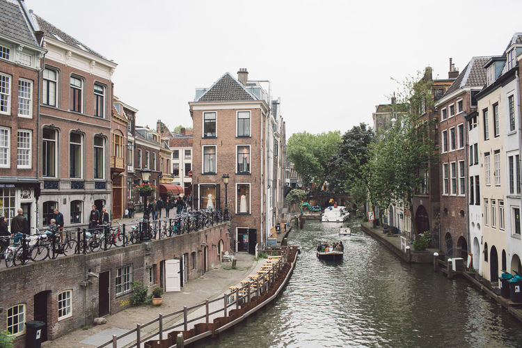 Architecture Building Building Exterior Built Structure Canal City City Life Clear Sky Day Incidental People Mode Of Transportation Nature Nautical Vessel Outdoors Passenger Craft Residential District Sky Transportation Water Waterfront Window