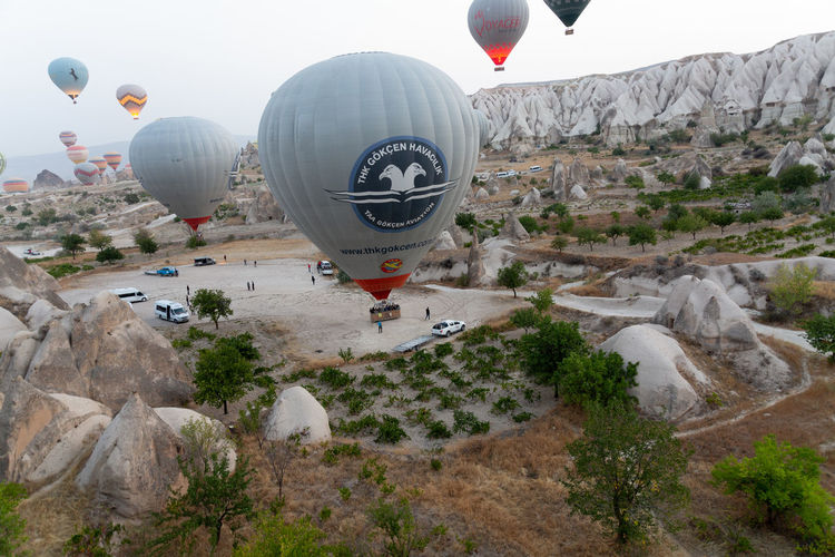 View of hot air balloon flying over rocks
